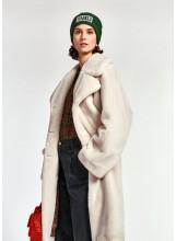 A/Manteau blanc cassé en fausse fourrure